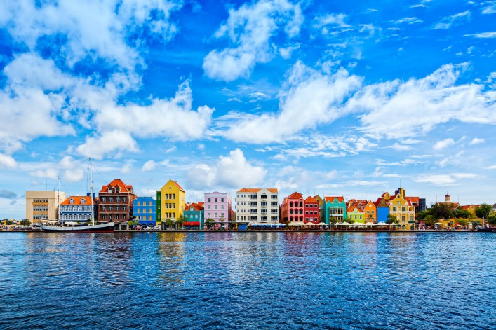 Historic houses with colorful facades at waterfront of Willemstad, Curaçao
