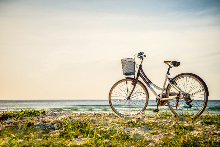 Bicycle parked in paradise island shutterstock_149302079-2