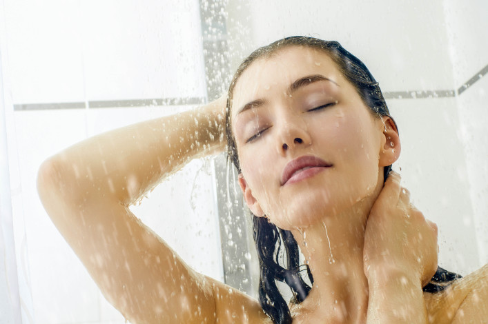 a beautiful girl standing at the shower shutterstock_129598883-2