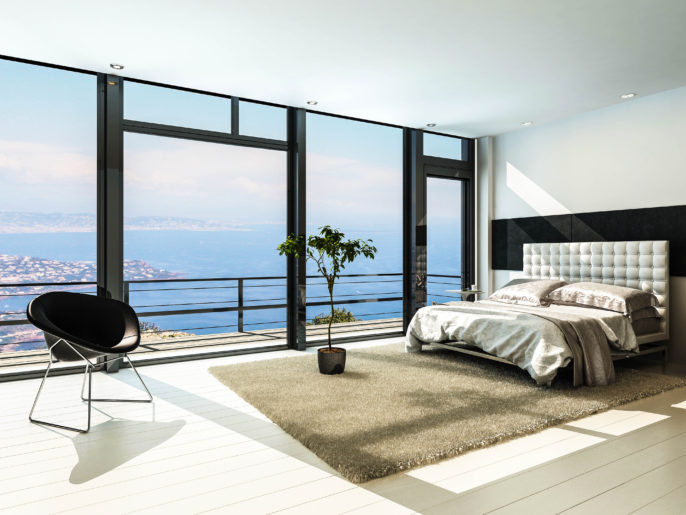Contemporary modern sunny bedroom interior with huge windows shutterstock_159600293-2