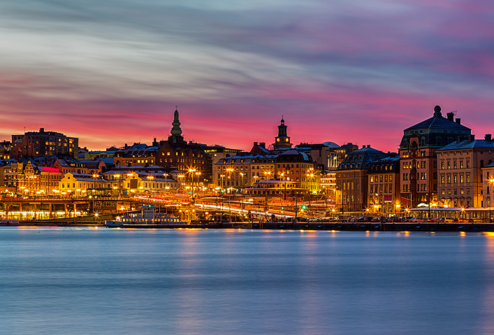 Stockholm city night image with pink sunset.