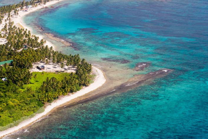 Aerial view of the barrier reef of the coast of San Pedro, Belize_shutterstock_168178208