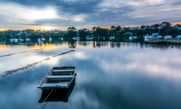 River scape at dawn, boat in forground iStock_000078289855_Large-2
