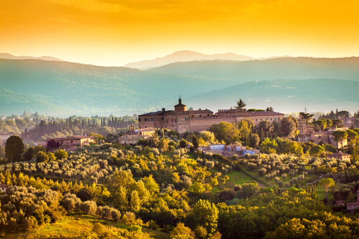 Tuscany Country Scenic Landscape of Vineyard and Hill Town Siena Italy iStock_000075361613_Large-2