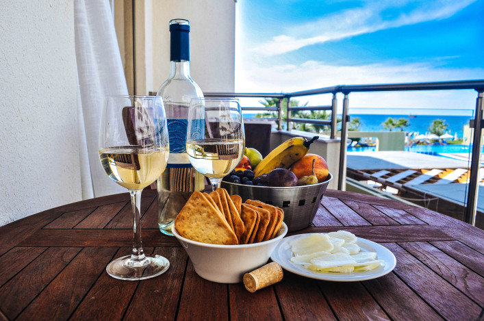 Wine with snack on a background of the sea