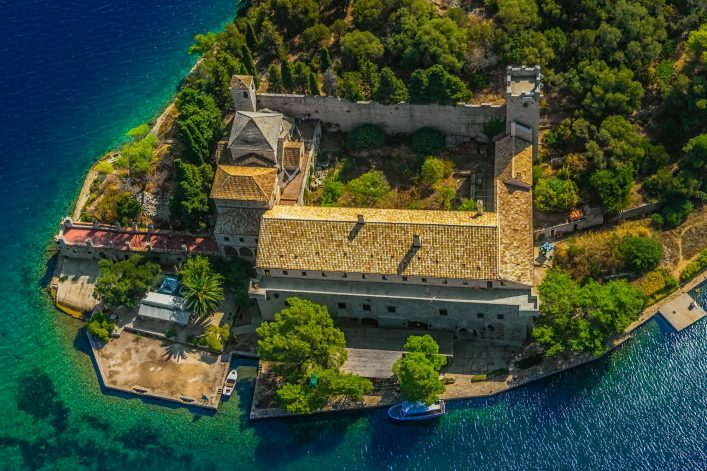 Aerial helicopter photo of Saint Mary monastery on litle island in national park Mljet, Croatia shutterstock_115428340-2