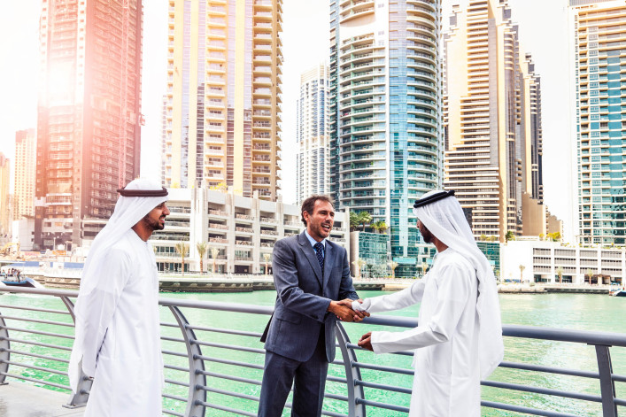 Businessmen struck a deal in Dubai iStock_000063159729_Large-2