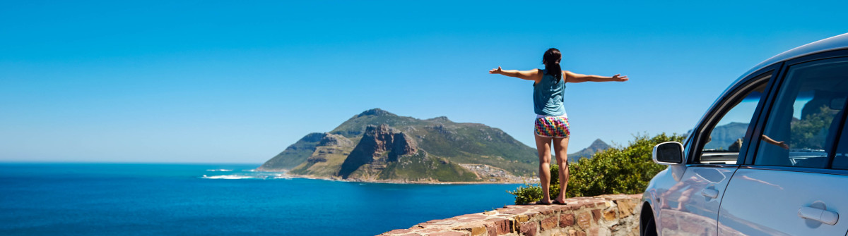 carefree tourist stands on chapmans peak drive shutterstock_126991940-2