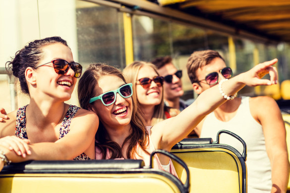 ruf Jugendreisen - group of smiling friends traveling by tour bus shutterstock_281448020-2