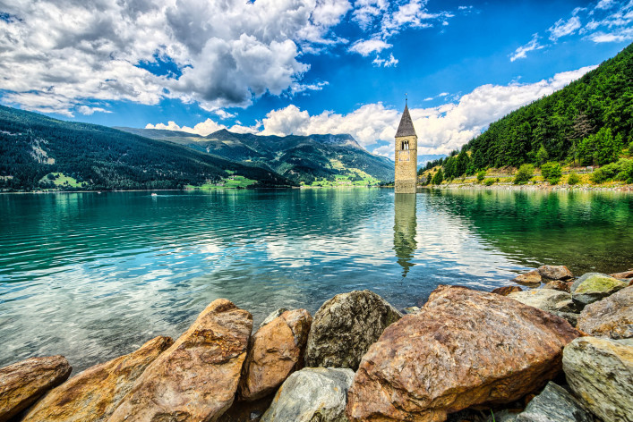Bell tower of the Reschensee (Resia) South Tyrol Italy shutterstock_314553251-2