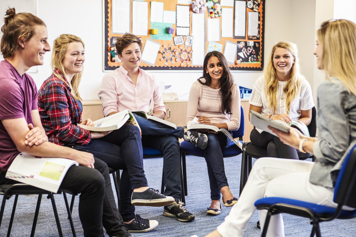 College Students With Tutor Having Discussion shutterstock_284521292-2