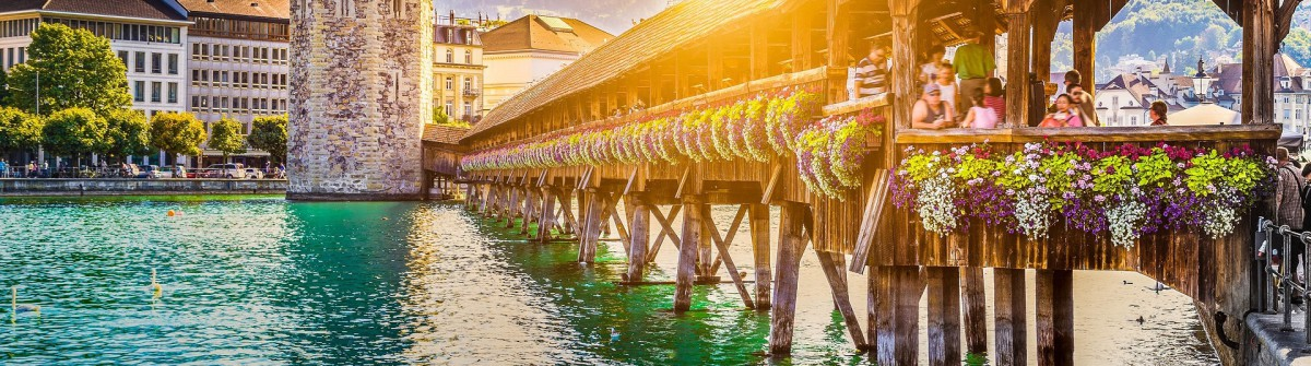 Historic city center of Lucerne with famous Chapel Bridge and Mount Pilatus shutterstock_332148542-2 1920