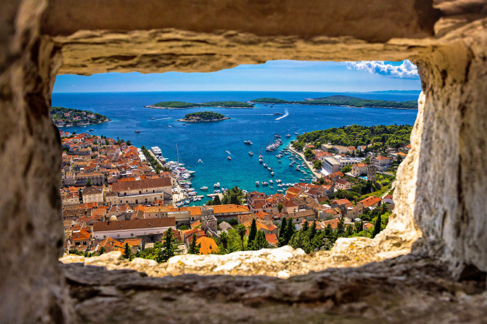 Hvar bay aerial view through stone window from Fortica fortress, Dalmatia, Croatia shutterstock_435327199-2