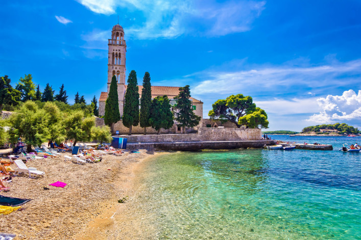Hvar island turquoise beach and stone church