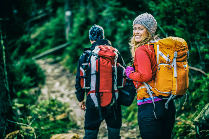 Man and woman hikers trekking in mountains shutterstock_231111064-2