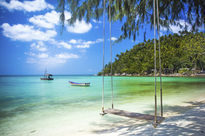 Swing hang from coconut tree over beach, Phangan island ,Thailand