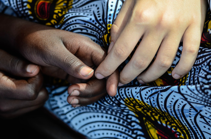 Symbol Of Peace – Black and White Women Holding Hands