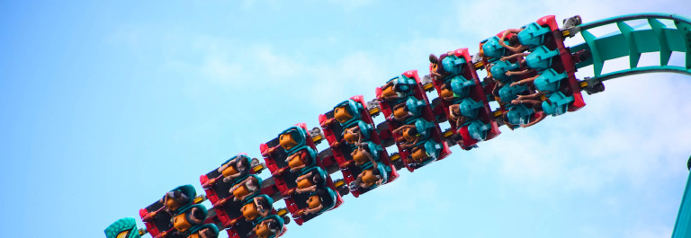 People riding a rollercoaster iStock_000044741246_Large-2