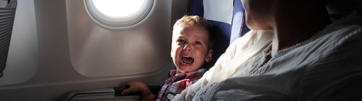 Child crying_plane_flight_shutterstock_223799005