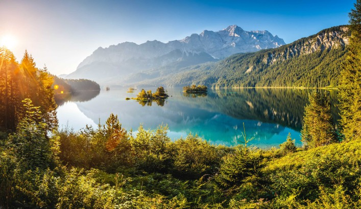 View of the islands and turquoise water at Eibsee Lake at the foot of Mt. Zugspitze shutterstock_397624216-2
