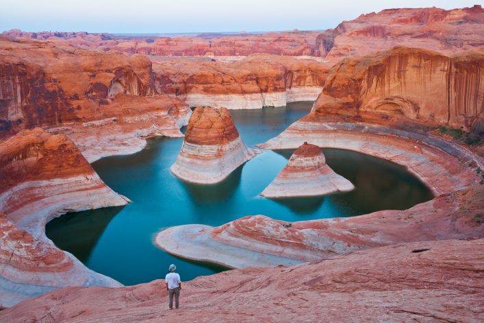A hiker overlooking Reflection Canyon, Glen Canyon National Recreation Area shutterstock_142239091