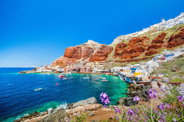 The old harbor of Ammoudi under the famous village of Ia at Santorini, Greece shutterstock_630008048
