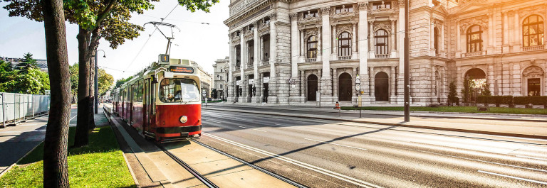 Wiener-Ringstrasse-with-tram-and-Burgtheater-at-sunrise,-Vienna-iStock_000060702174_Large-2