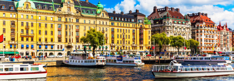Scenic summer panorama of the Old Town (Gamla Stan) pier architecture in Stockholm, Sweden_shutterstock_161753954-2