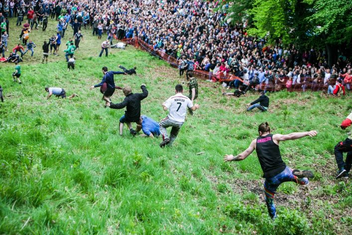 Entrants-chasing-the-cheese-at-the-2015-Cheese-Rolling-iStock_000065768927_Large-EDITORIAL-ONLY-Raylipscombe-2