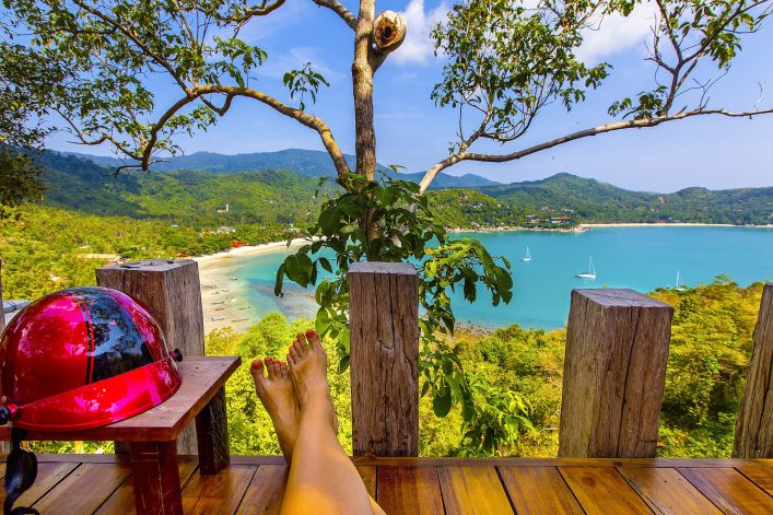 Ao Thong Nai Pan viewpoint view with legs of resting woman and helmet, Koh Phanga shutterstock_637028125-2_klein