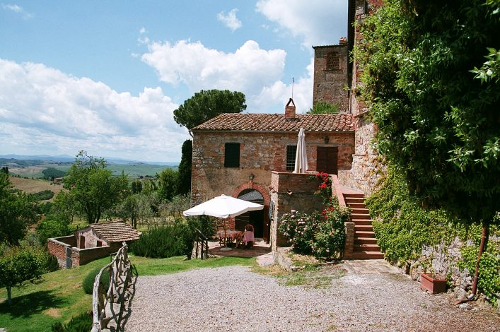 tuscan holiday villa with blue sky gravel courtyard