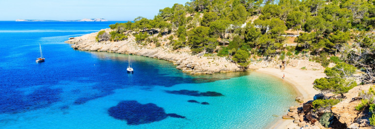 Cala-Salada-bay-famous-for-its-azure-crystal-clear-sea-water-Ibiza-island-Spain-shutterstock_647770648