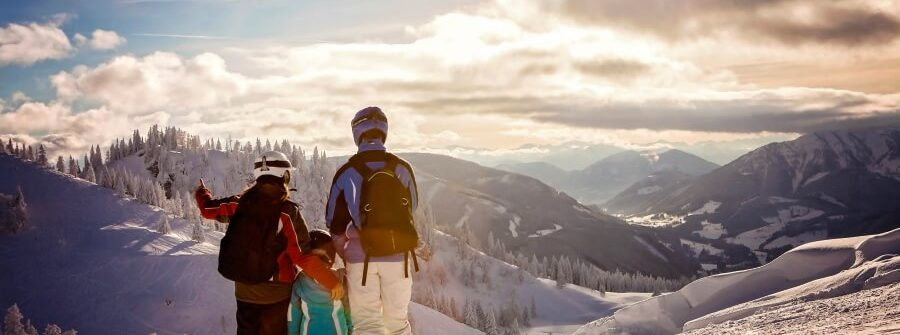 family-in-winter-clothing-at-the-ski-resort-iStock_73558605_900x600