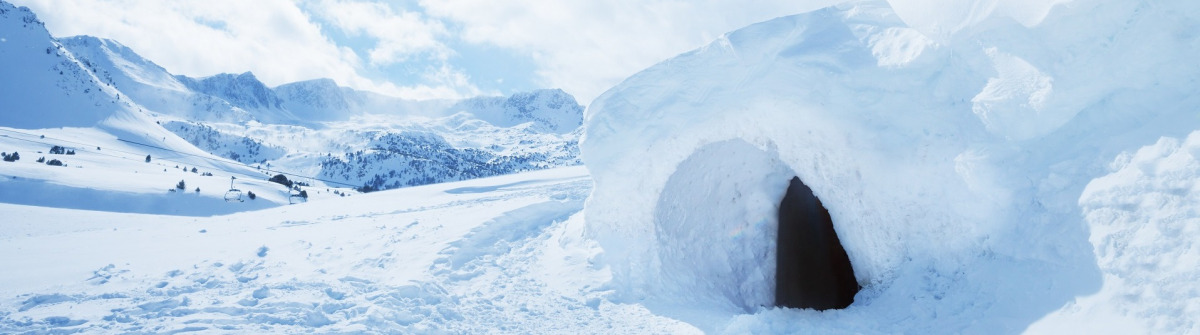 igloo-and-snow-shelter-in-high-snowdrift-with-mountains-peaks-on-background-shutterstock_151847828