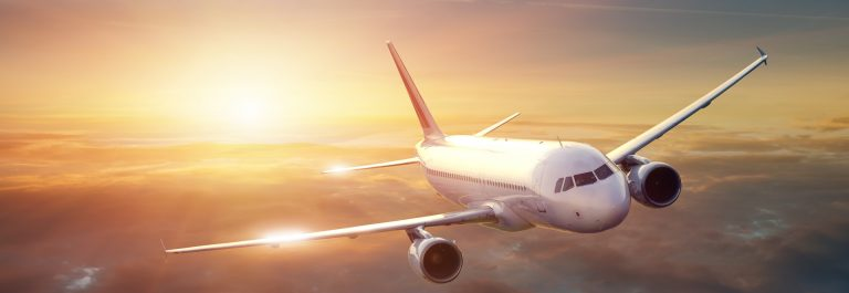 Airplane in the sky at sunset_shutterstock_110793839