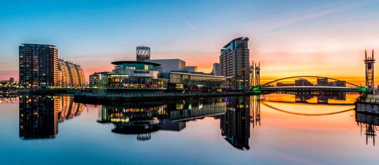 Orange Sunrise At Salford Quays With Reflections.