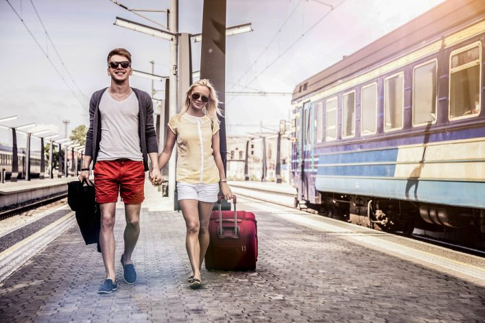 Young couple waiting for a train on platform iStock_000031131506_Large-2