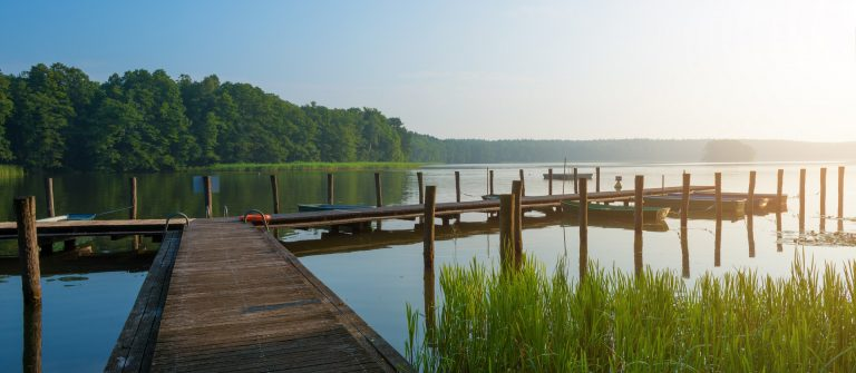 Morning light at a lake in Mecklenburg with landing stage