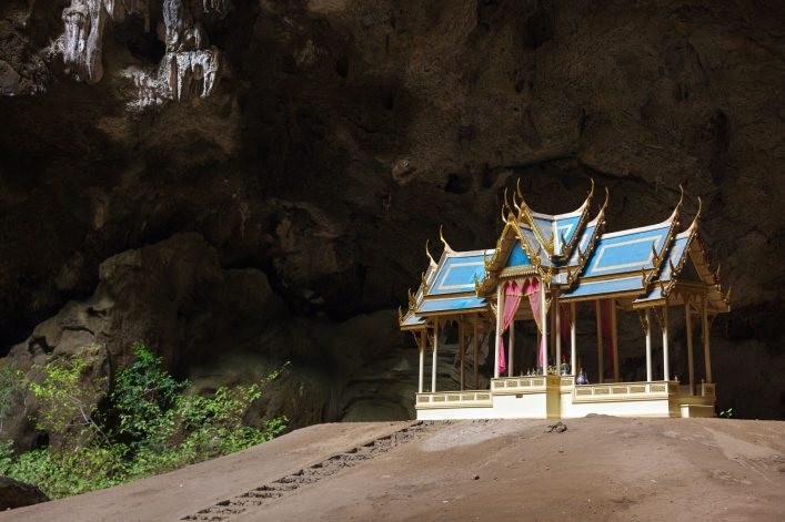 Buddhist temple in natural caves, Sam Roi Yot, Thailand shutterstock_123064600