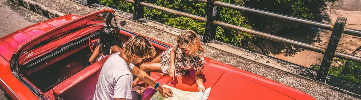happy-young-people-in-convertible-car-istock_63189825_xlarge-2-1