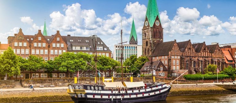 Historic town of Bremen with old sailing ship on Weser river, Germany_shutterstock_221851978