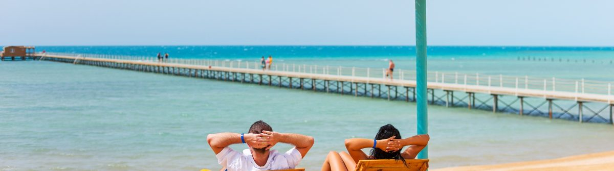 Relax of loving couple on the beach at Red Sea in Egypt