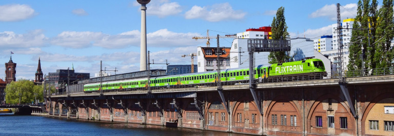 FlixTrain_Berlin_Bridge_River_Tower