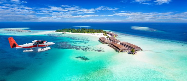 Aerial-view-of-a-seaplane-approaching-island-in-the-Maldives-shutterstock_605726798