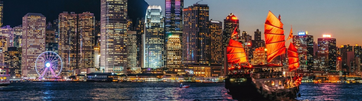 Cityscape Hong Kong and Junkboat at Twilight
