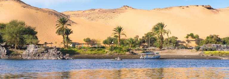 Sunset-Sand-dunes-on-the-Coastline-of-the-Nile-river-part-called-First-Cataract-Aswan-Egypt_238837702
