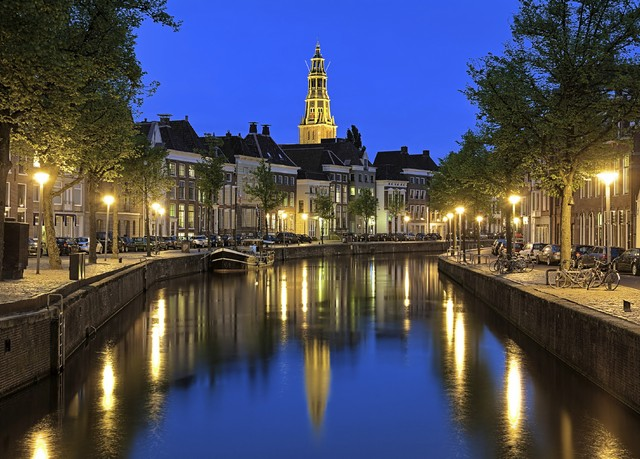 Evening view of Aa river with tower of  A-Church in Groningen, N