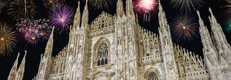 Cathedral with fireworks - New Year in Milan, Italy_shutterstock_600718304