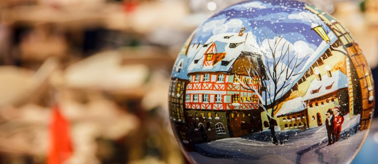 Christmas bauble depicting snowy German street