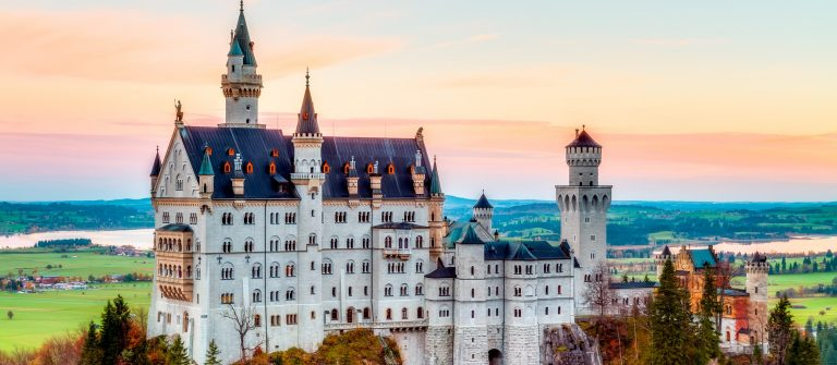 Neuschwanstein-Lovely-Autumn-Landscape-Panorama-Picture-of-the-fairy-tale-castle-near-Munich-in-Bavaria-Germany-with-colorful-trees-in-the-morning-hours-shutterstock_163531187-Copy
